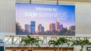 Welcome to the Sage Summit banner outdoors